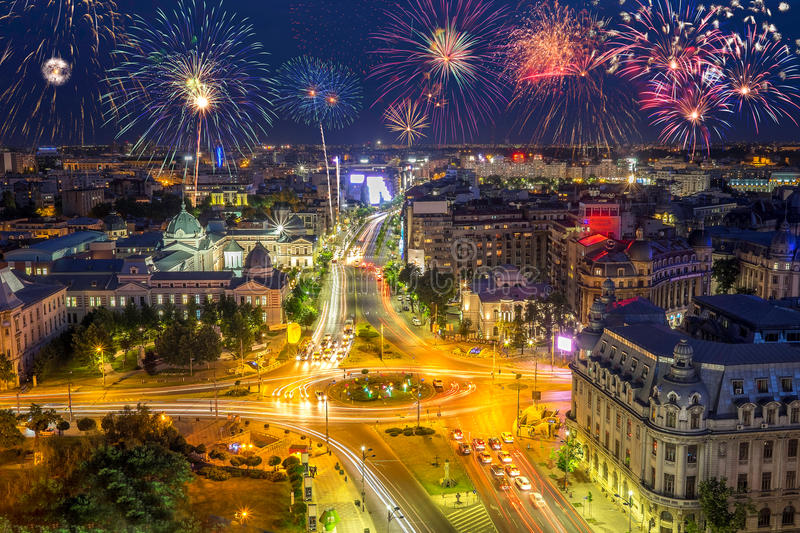 University Square in Bucharest Romania with fireworks in the sky royalty free stock photo