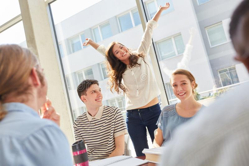 University student celebration after exam. Woman as young university student in celebration pose after success in exam royalty free stock images