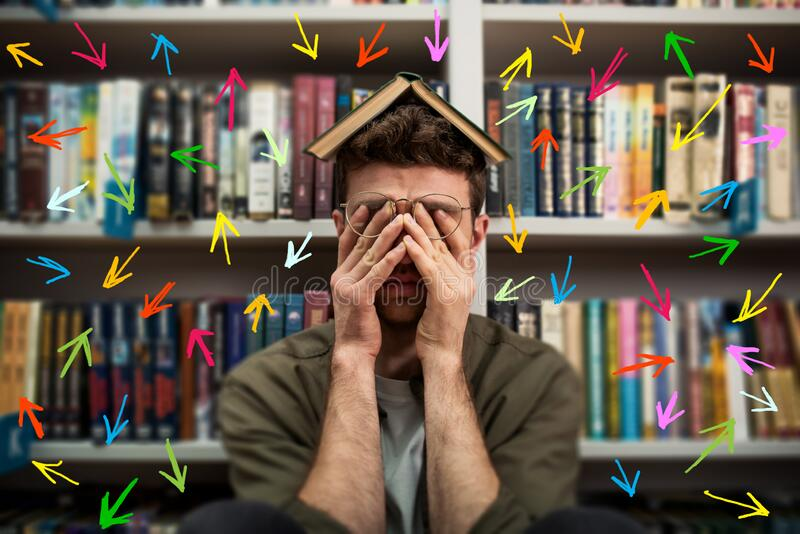 Tired university student has difficulty to study. Full of arrows and way to follow. Concept of stress and difficulty stock photo