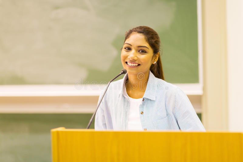 University student speech. Young indian university student delivers a speech in lecture hall stock image