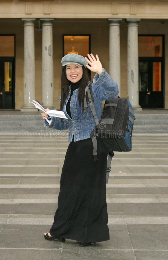 University - Student waving to fellow students stock photography