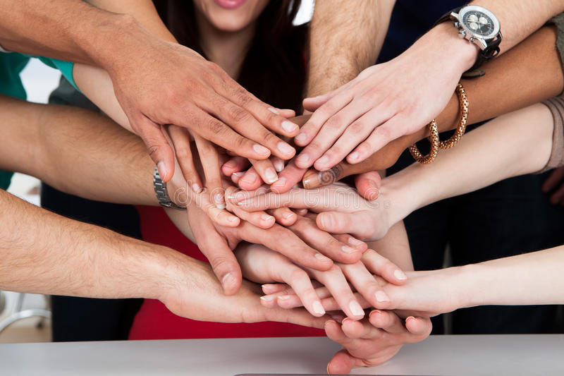 University students piling hands royalty free stock image