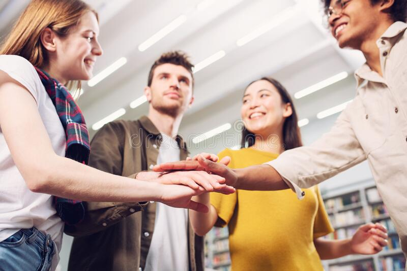 University Students put their hands together. Concept of teamwork and partnership royalty free stock photos