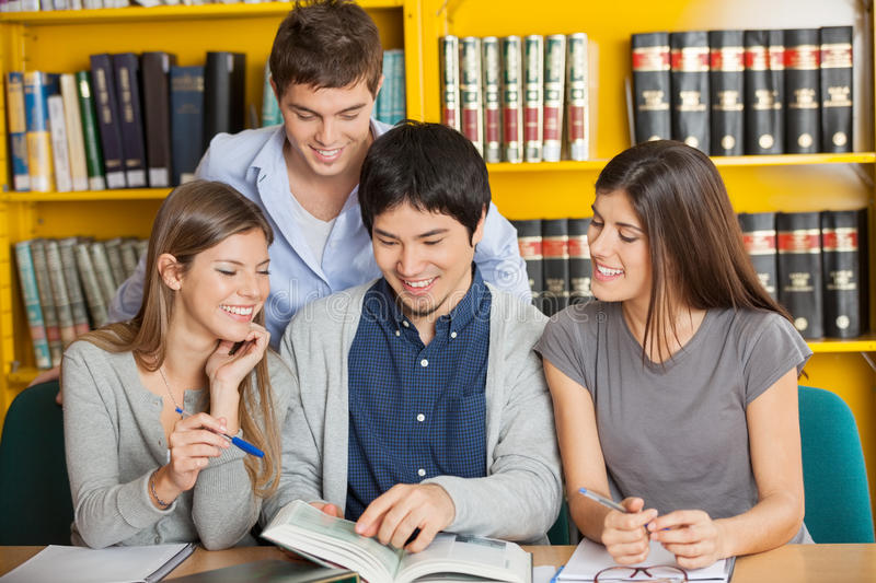 University Students Studying Together In Library royalty free stock photography