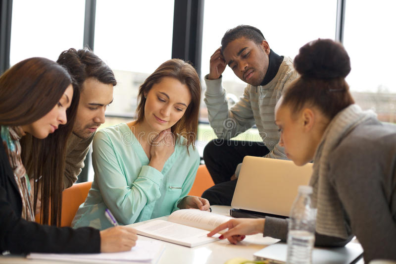 University students working together on project stock photo
