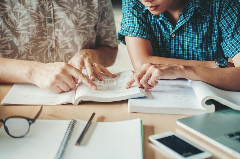 University studying friends studying and reading a books in classroom royalty free stock photos