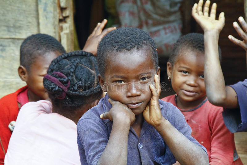 Unknown african children laughing in Malgasy village. stock photo