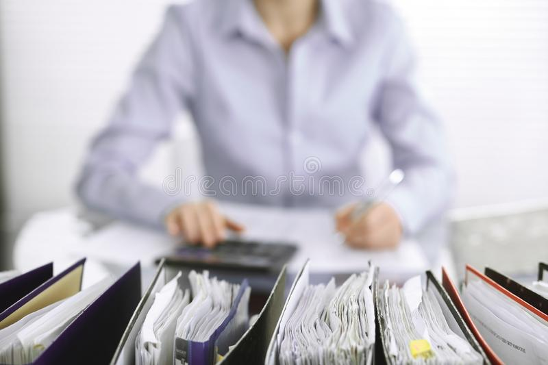 Bookkeeper woman or financial inspector making report, calculating or checking balance, close-up. Business, audit or tax. Unknown bookkeeper woman or financial stock images