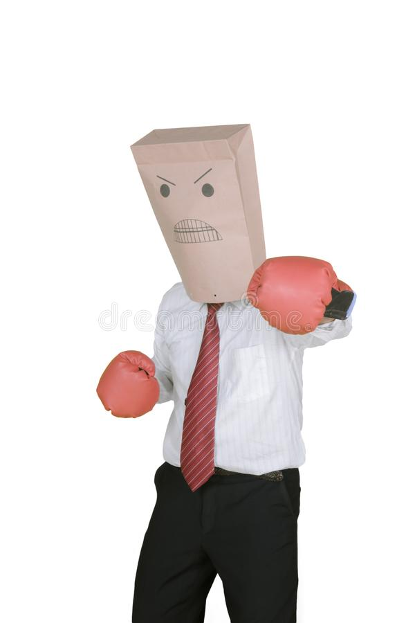 Unknown businessman with boxing gloves on studio stock photo