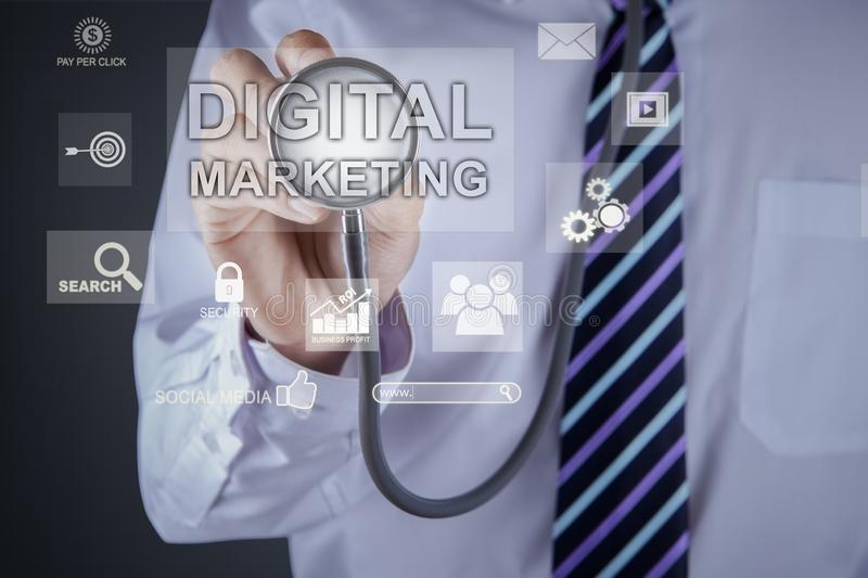 Unknown doctor touches digital marketing text. Close up of unknown doctor hands touching digital marketing text on the virtual screen by using a stethoscope royalty free stock photos