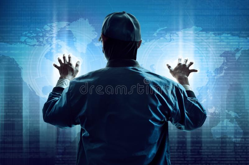 Anonymous hacker stealing computer data stock images
