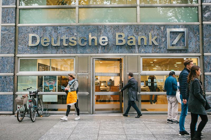 Berlin, October 2, 2017: Unknown man walks into the beautiful glass office of Deutsche Bank. Unknown man walks into the beautiful glass office of Deutsche Bank stock photo