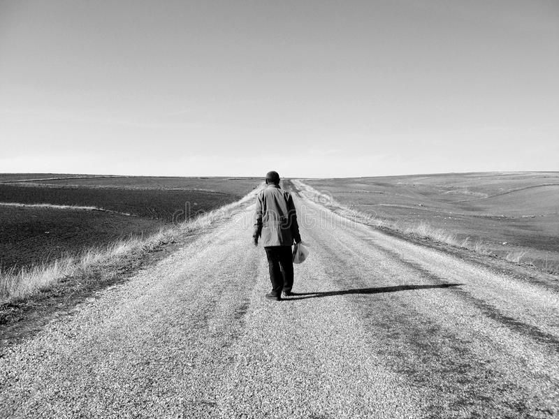 Unknown passenger and asphalt road Loneliness, obscurity and passenger stock photo