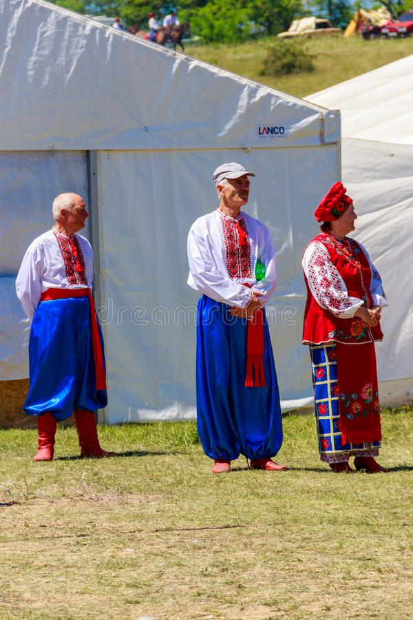 Unknown people in traditional ukrainian clothing during ethno-rock festival Kozak Fest stock photography