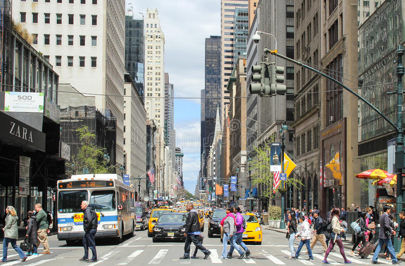 Unknown people who walked across the road on crosswalk to cross the street in New York City, USA. royalty free stock images