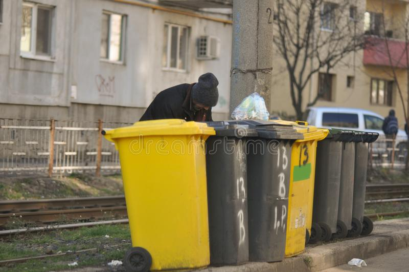 Dumpsters and homeless man royalty free stock image