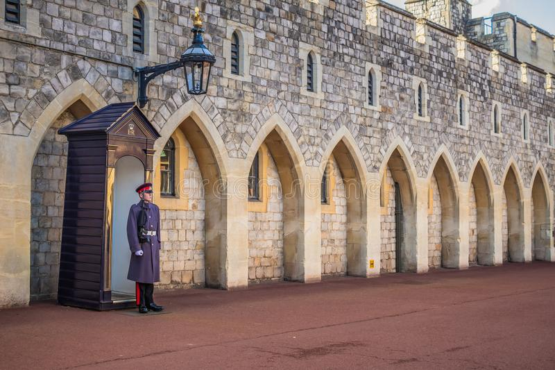 Unknown Queen`s guard watching over Windsor Castle stock images