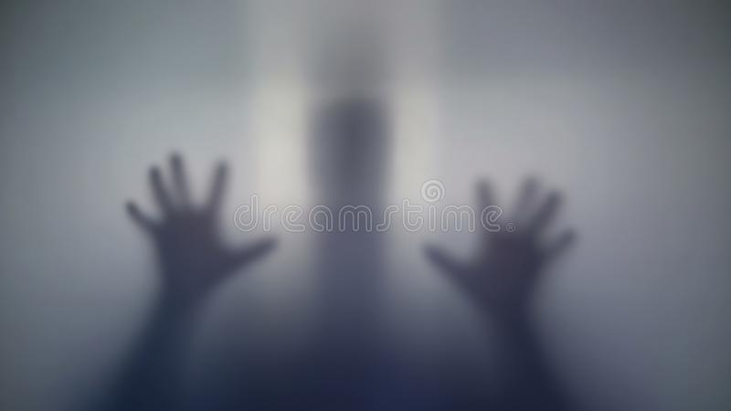 Unknown silhouette quietly sneaking up, intimidating people, strange creature. Stock photo stock photos