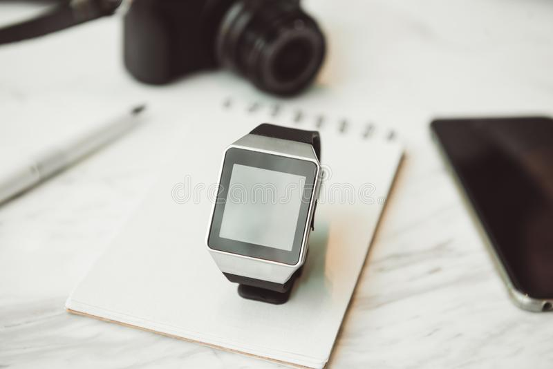 Unknown smart wrist watch laying on the table.  stock image