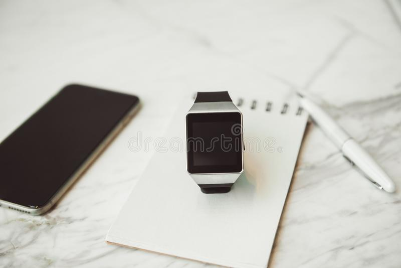 Unknown smart wrist watch laying on the table.  stock photography
