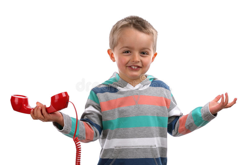 Unknown telephone call. Boy shrugging and gesturing whatever with his hands after an unknown telephone call stock images