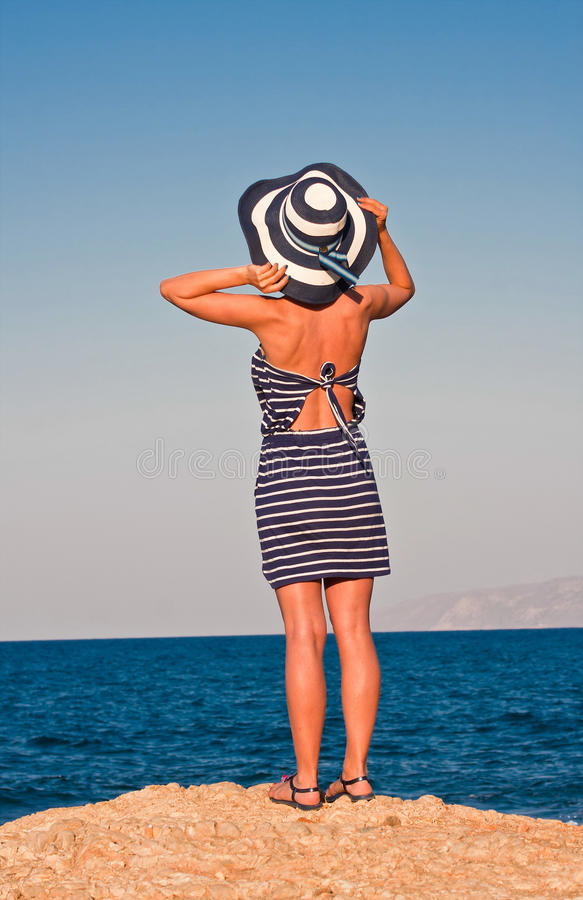 Unknown woman at sea shore stock photos