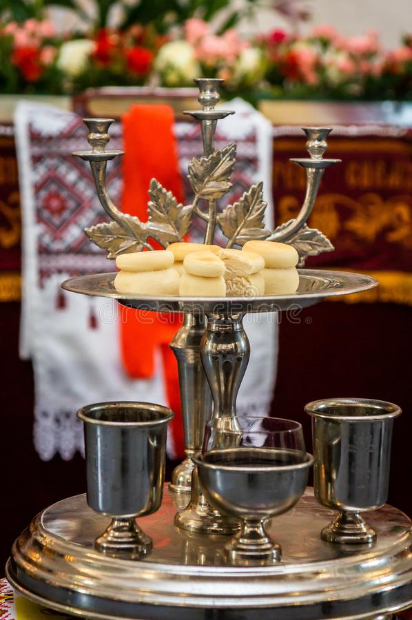 Unleavened bread on a silver tray with candle holder-triceram. The Eucharist — liturgical bread used in the Orthodox Church for the sacrament of the stock photo