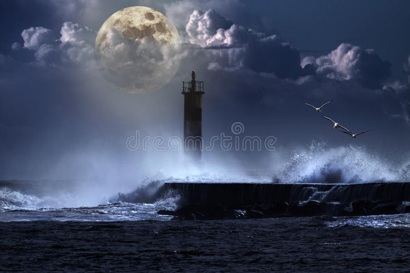 Unlit beacon. Conceptual image over an unlit beacon in a stormy full moon night royalty free illustration