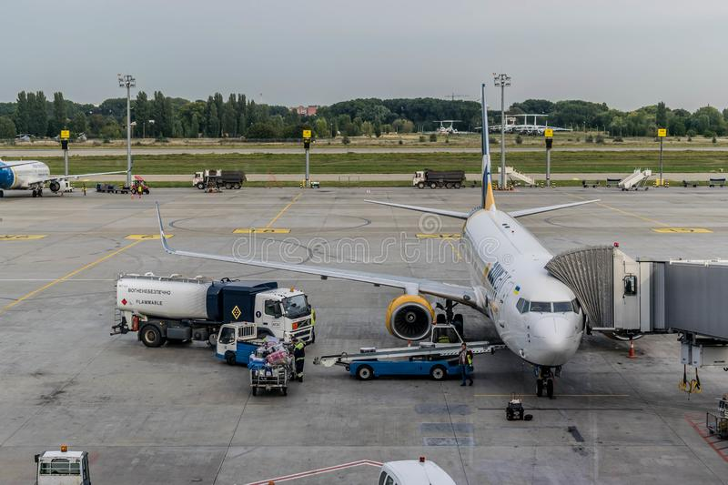 Unloading baggage from a Boeing aircraft after the flight stock photography