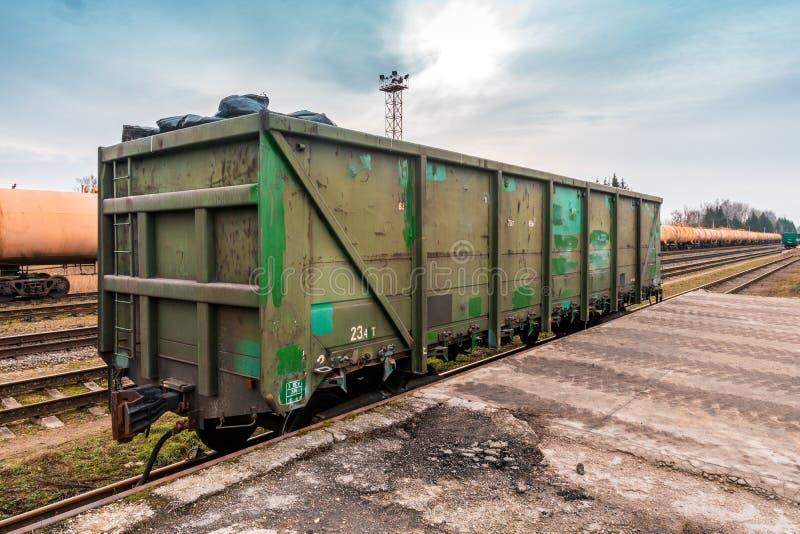 Unloading bulk cargo from railway wagon stock photo