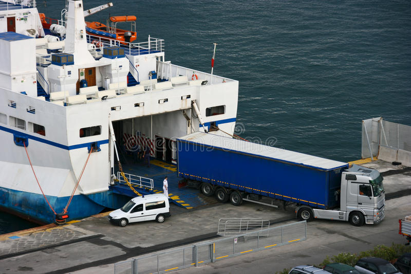 Unloading cargo from the ship royalty free stock photos