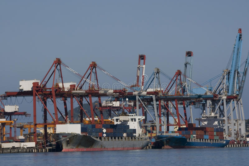 Unloading a Cargo Ship in a Port royalty free stock images