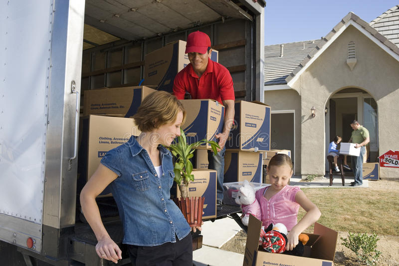 Unloading Delivery Van By New House stock photos