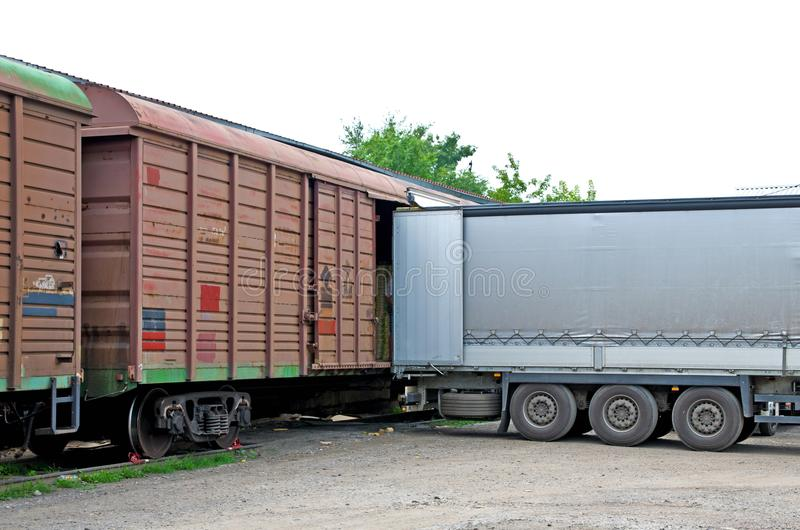 Unloading a freight car into a wagon royalty free stock photo