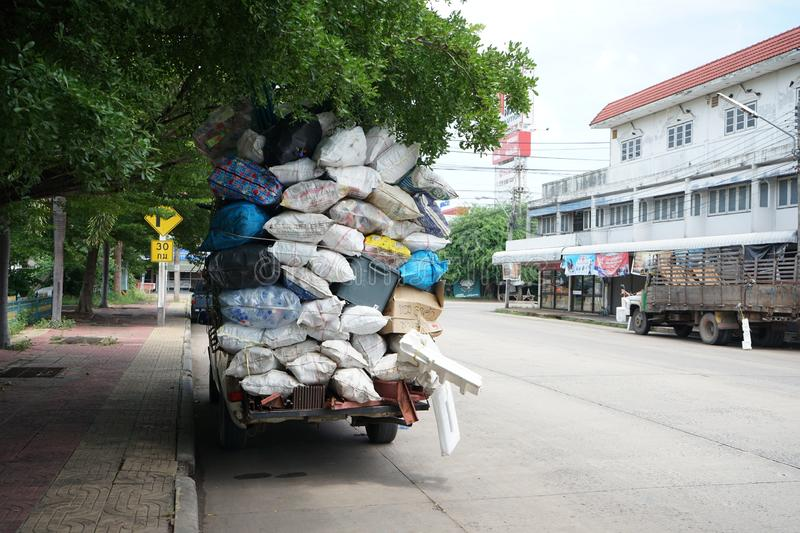 Unloading material for sale Parked on the side of the road waiting to be sold. Surin, Thailand - 28 July 2019: Unloading material for sale Parked on the side of royalty free stock image
