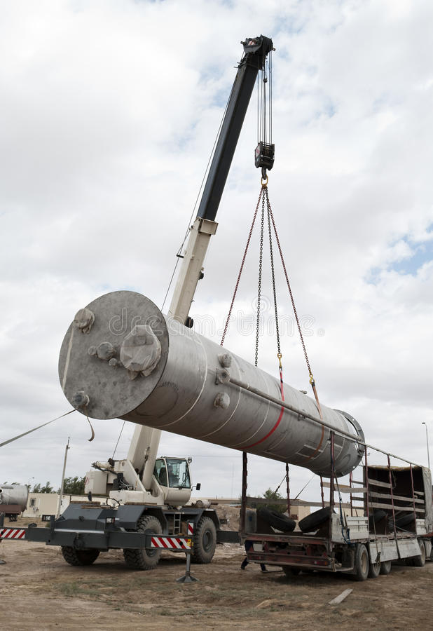 Free Unloading Of Processing Equipment By Means Of The Crane Stock Photography - 41153072