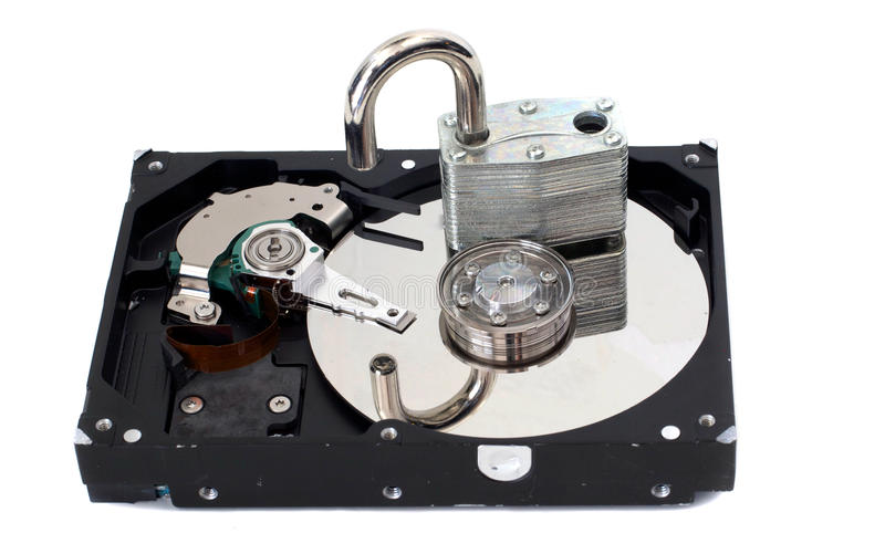 Unlocked Padlock on a Hard Disk Drive. A strong padlock unlocked on top of a hard disk drive. Depicts a lack of security stock photos