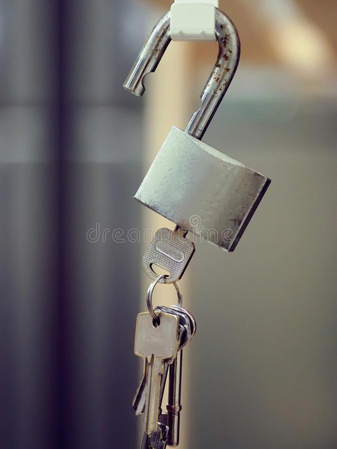 Hanging padlock with bucnh of keys royalty free stock photography