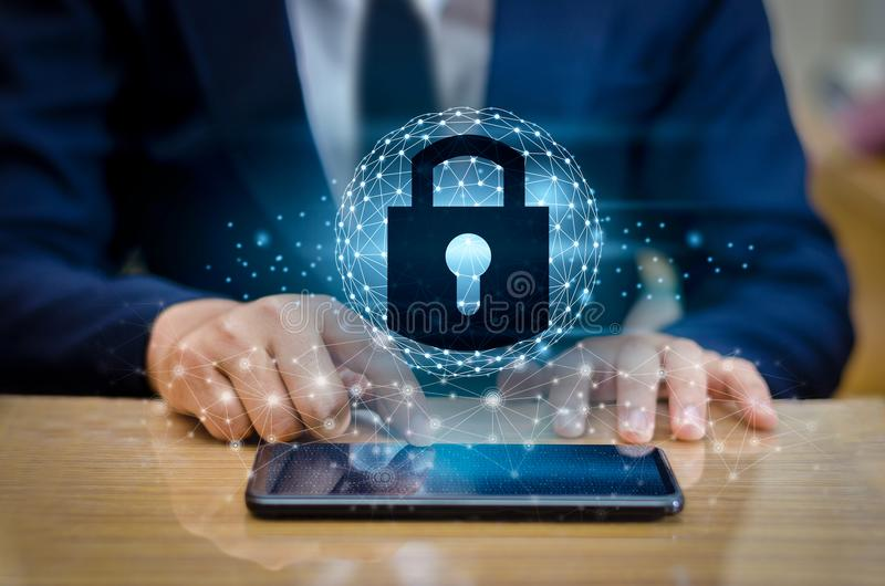 Unlocked smartphone lock Internet phone hand Business people press the phone to communicate in the Internet. Cyber security concep. T hand protection network stock photo