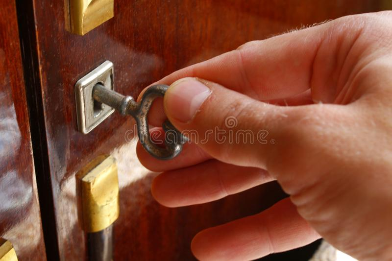 The key in the lock. Unlocking the safe lock with a key royalty free stock image