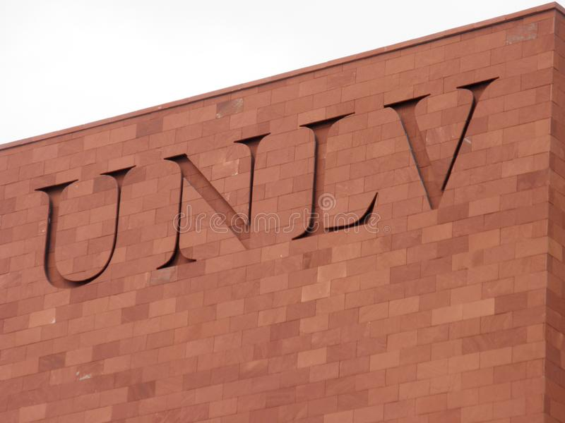 UNLV Logo on side of Red Brick building. Las Vegas - February 5, 2010: UNLV Logo on side of Red Brick building. The University of Nevada, Las Vegas is a public royalty free stock images
