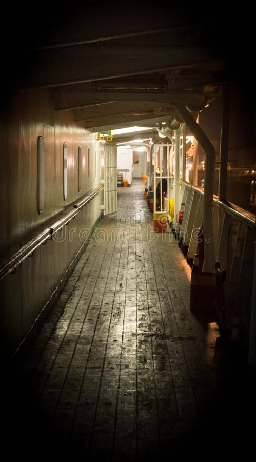 Unmanage ship cruise deck on the night with dirty wooden floor royalty free stock photography