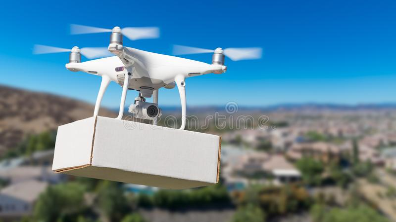 Unmanned Aircraft System UAS Quadcopter Drone Carrying Blank Box royalty free stock images