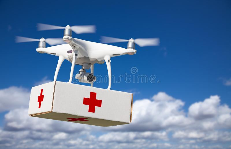 Unmanned Aircraft System UAS Quadcopter Drone Carrying First Aide Kit stock photography
