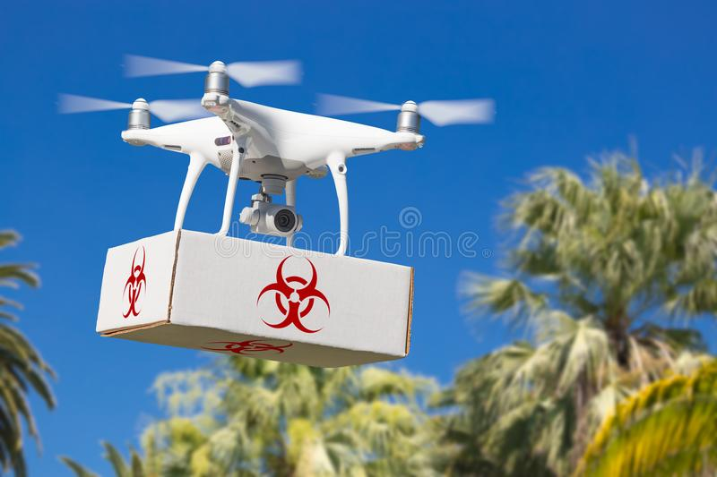 Unmanned Aircraft System UAV Quadcopter Drone Carrying Package stock photo