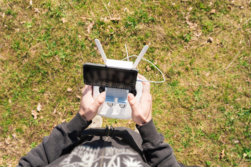 Unmanned copter. Man controls quadrocopter flight. stock photos