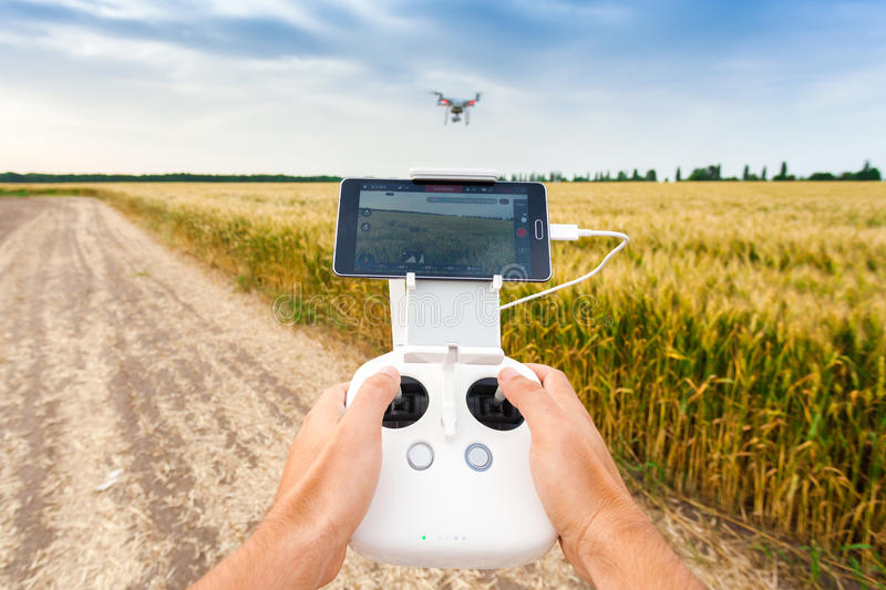 Unmanned copter. Man controls quadrocopter flight. royalty free stock photos