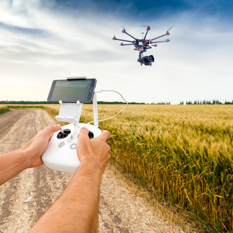 Unmanned copter. Man controls quadrocopter flight. stock images