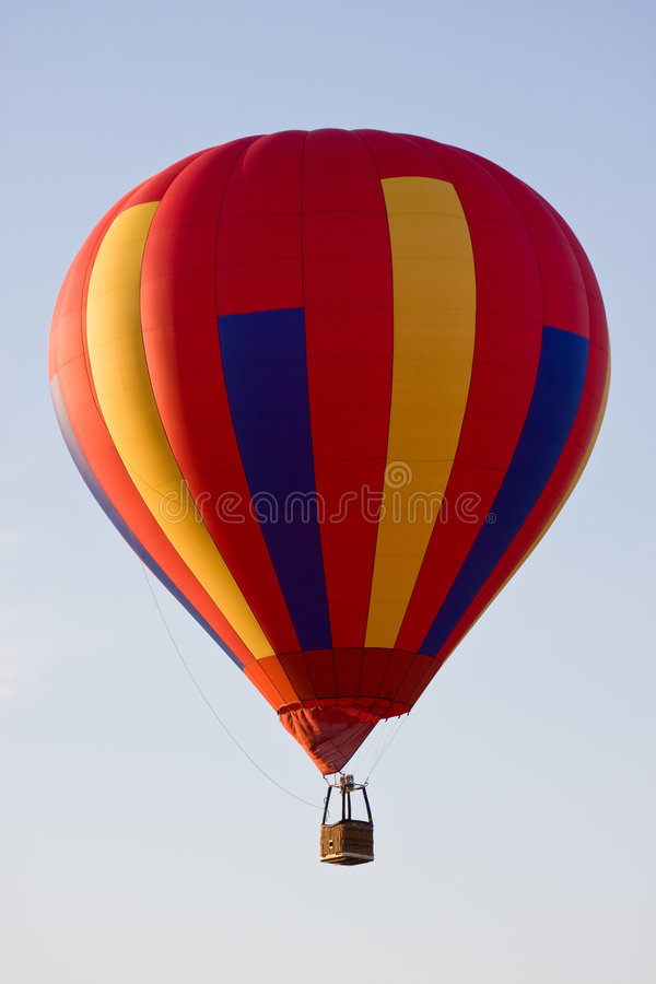 Unmanned Hot Air Balloon!. A colorful hot air balloon in mid-air on a clear day with no one on board! Put your own favorite balloon pilot in the gondola royalty free stock photos