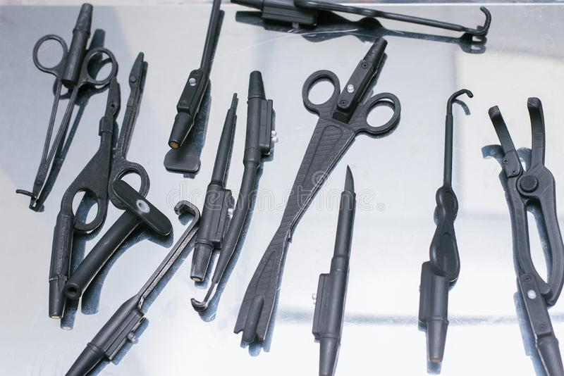 Unnatural medical instruments and accessories for virtual surgery. Plastic forceps, clamps, medical devices for 3D operations stock image
